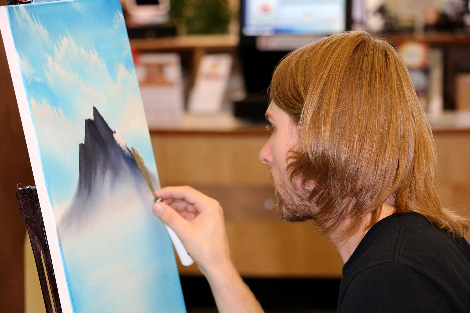 Artist Painting a mountian