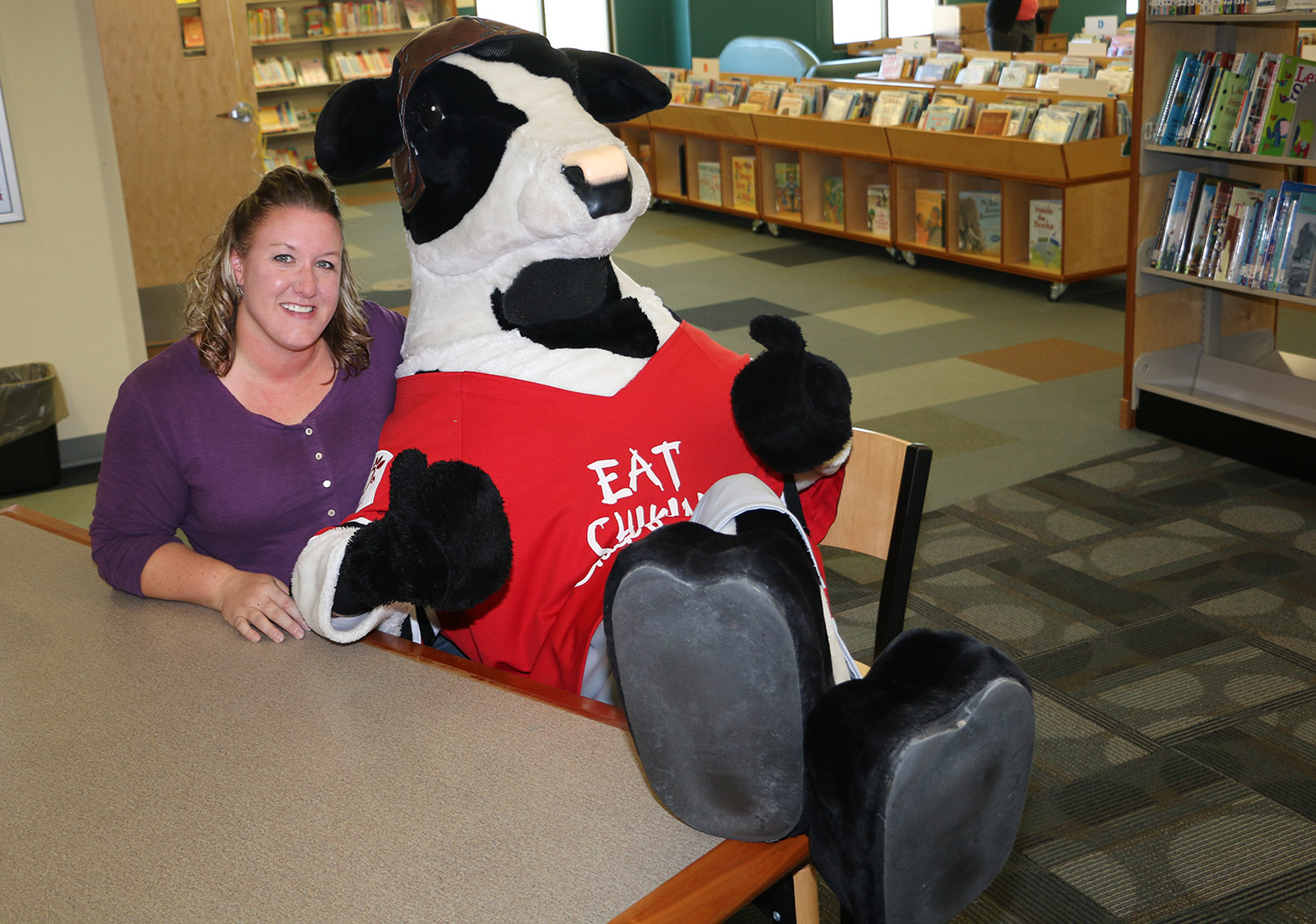 Chick Filet cow sitting on ladies lap